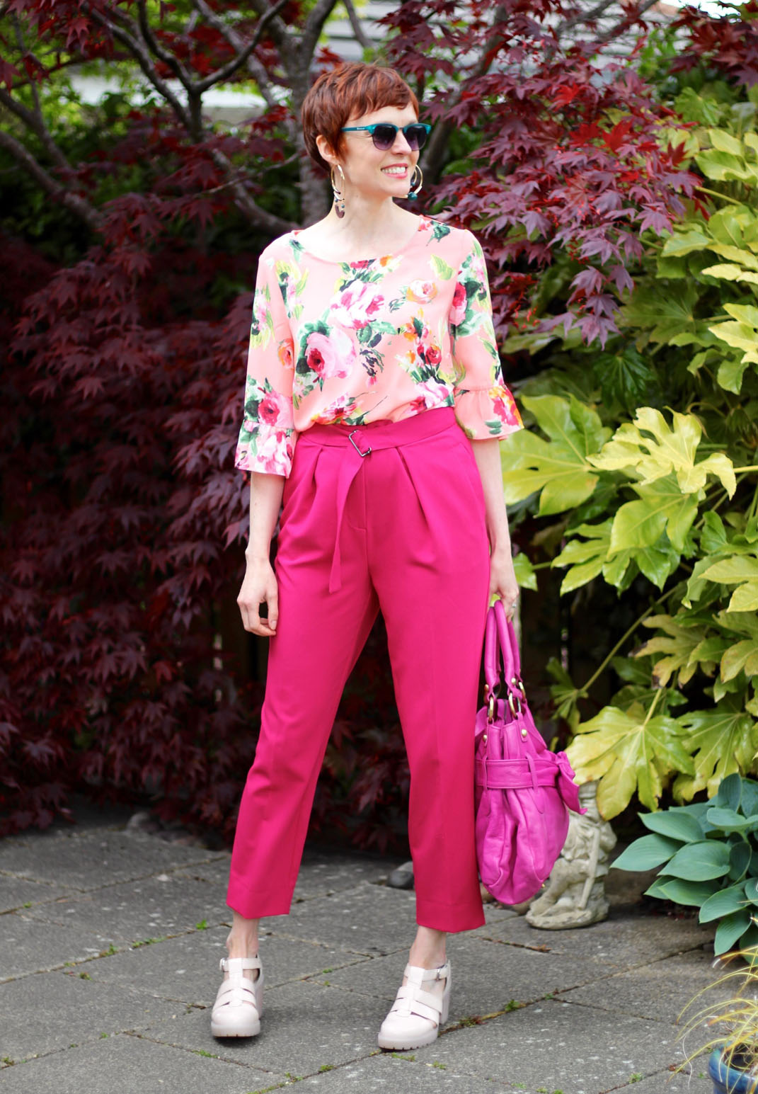 Over 40 fashion blogger Samantha of Fake Fabulous in pink florals