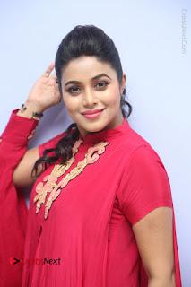 Actress Poorna Latest Stills in Red Dress at Rakshasi First Look Launch  0137.JPG