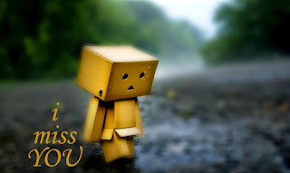carton box boy walking on road with i miss you text