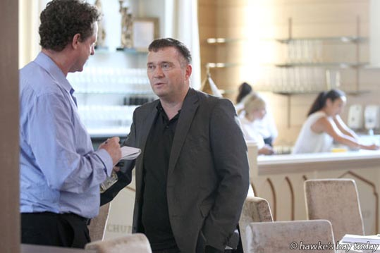 L-R: Patrick O'Sullivan, ace business reporter, Hawke's Bay Today, interviewing Chris Quin, North Island manager, Foodstuffs, guest speaker at an Icehouse Christmas lunch at The Old Church., Meeanee, Napier. photograph