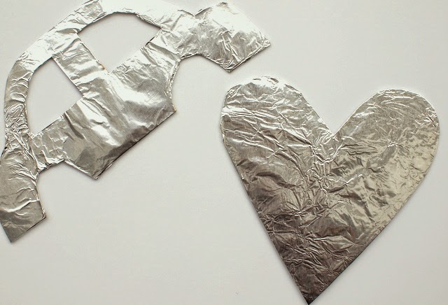 wrap cardboard in aluminum foil to make candy mosaic kids art