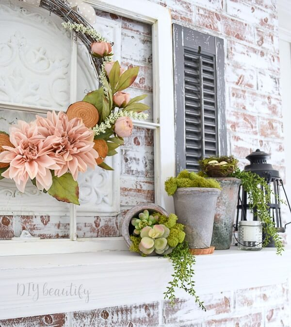layered mantle with wreath and succulents