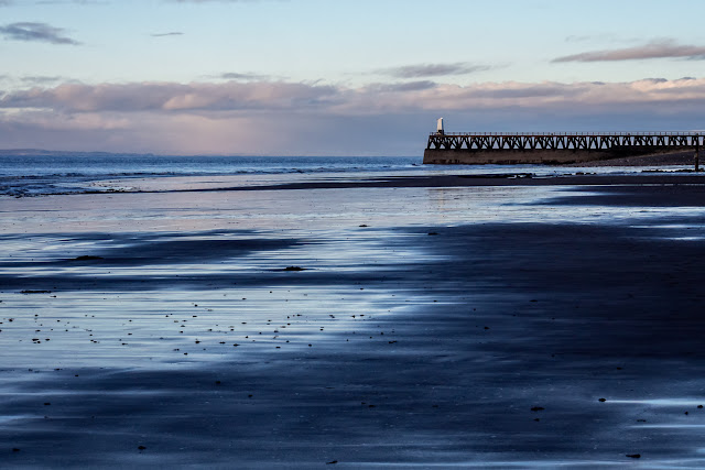Photo of Maryport shore and pier at low tide