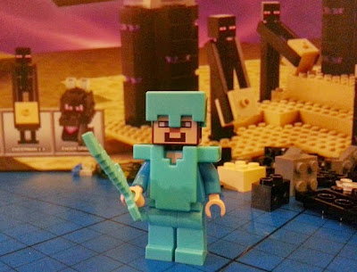 Boys building LEGO Minecraft set 21117 - The Ender Dragon Steve in diamond armour