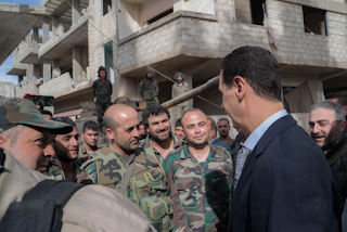 Bashar al-Assad visits army positions Sunday in the eastern region of Ghouta