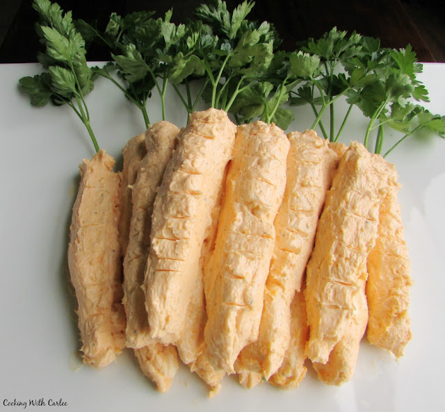 carrot shaped cheese balls with parsley toppers