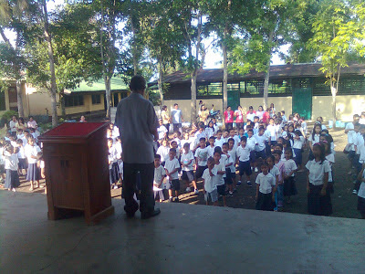 The school principal giving instructions to pupils