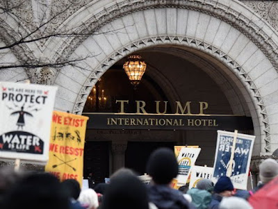 The Native Americans also carry their protest to a Trump hotel