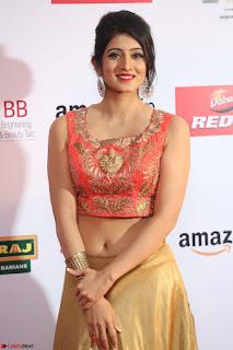 Harshika Ponnacha in orange blouuse brown skirt at Mirchi Music Awards South 2017 ~  Exclusive Celebrities Galleries 038.JPG