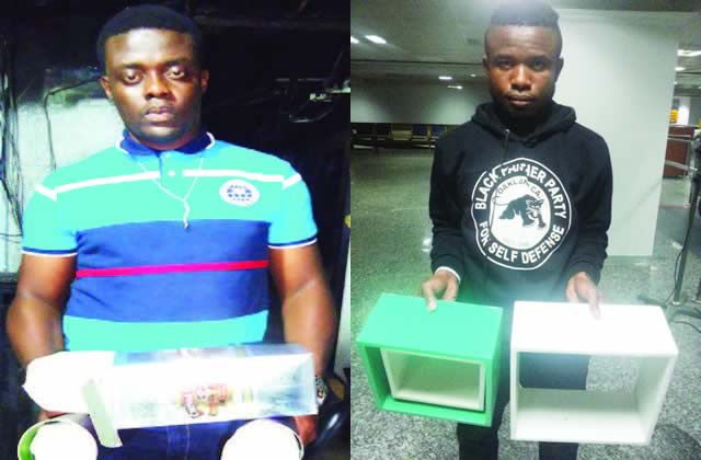 2 men with N59m cocaine hidden in whiskey packs!