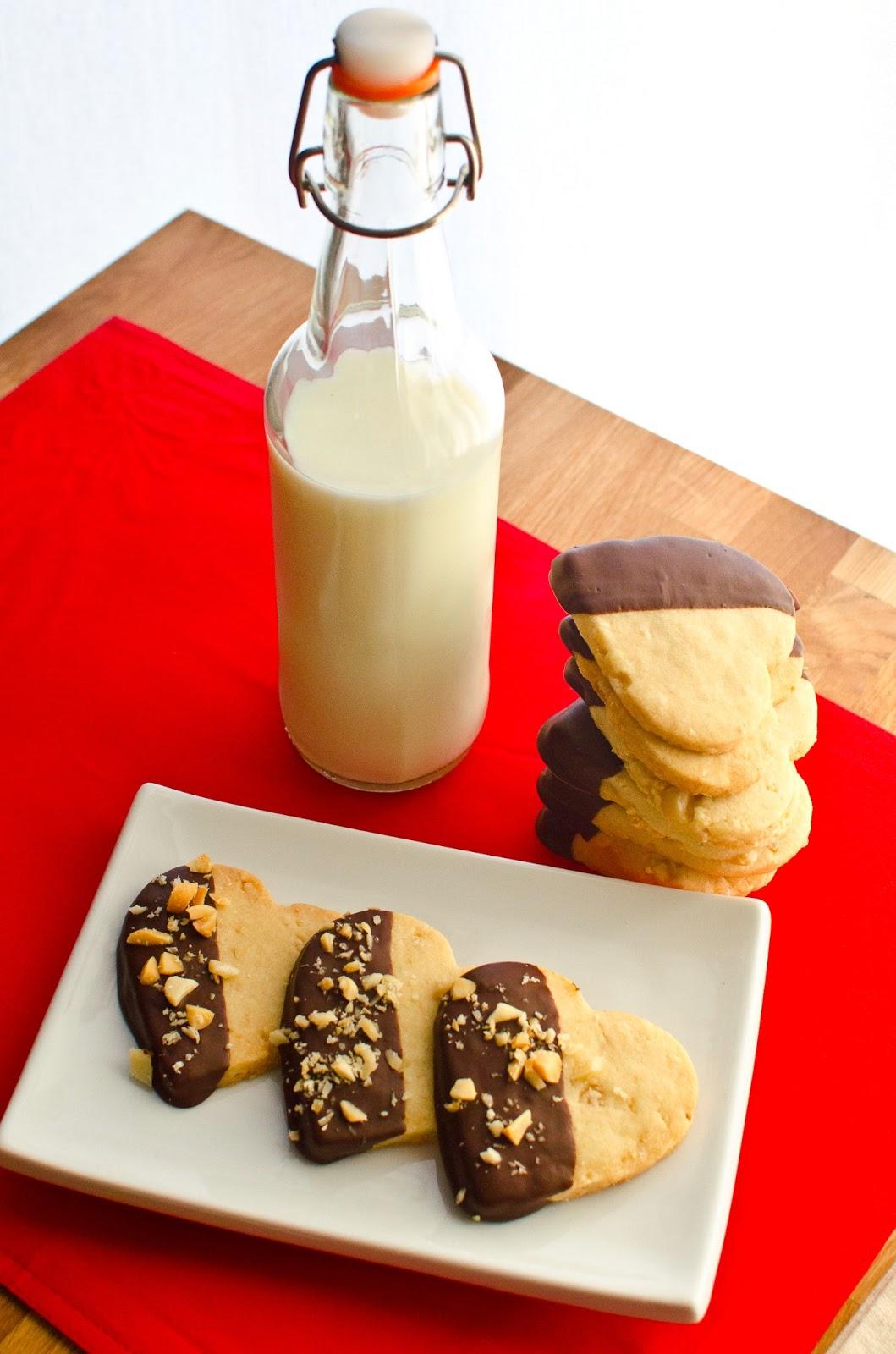 Dark chocolate dipped macadamia nut shortbread cookies