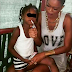 Photo - Mum lights up marijuana for her underage daughter