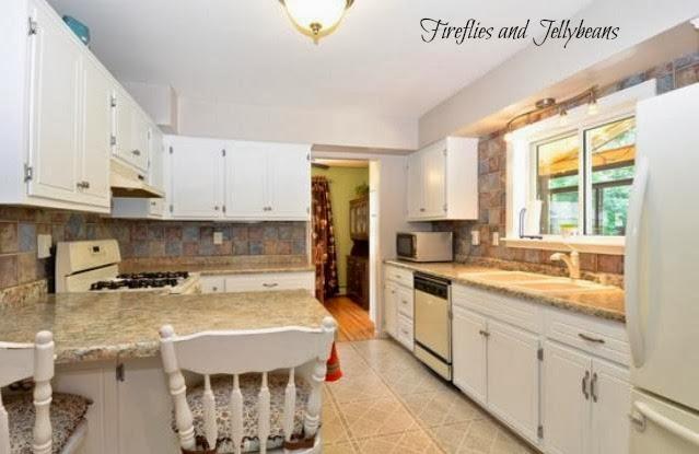 Kitchen Gray Floor White Cabinets