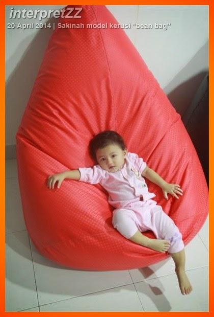 Baby Sakinah on red bean bag chair at Sepang, Selangor, Malaysia.