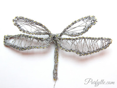 Make dragonfly style fairy wings with wire and silver braid.