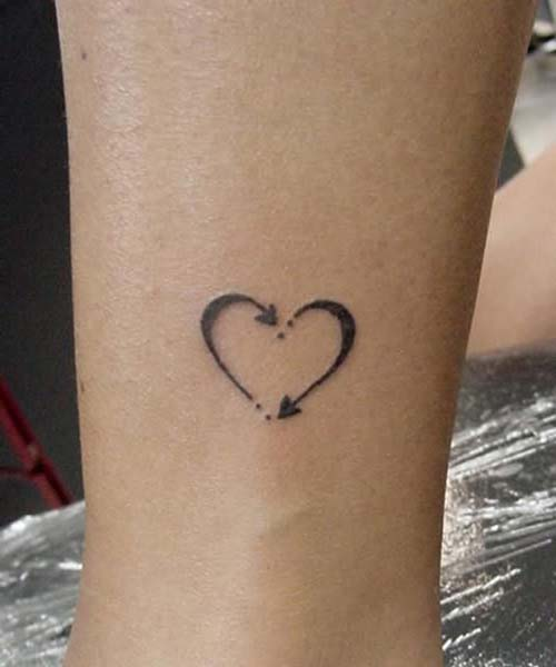 oklu kalp dövmesi arrow heart tattoo