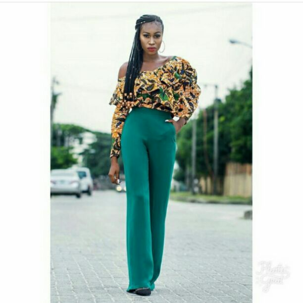 one-hand ankara top with green pants