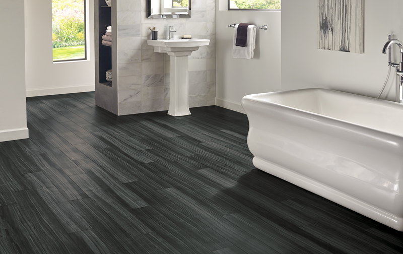 hardwood look porcelain and luxury vinyl that looks like wood are great waterproof flooring options for bathrooms