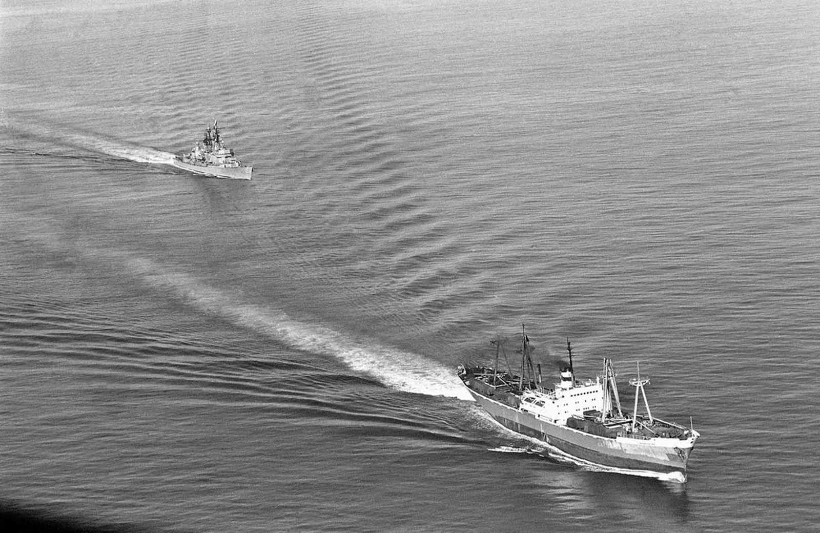 The U.S. Navy guided missile ship Dahlgren trails the Soviet Leninsky Komsomol as the Russian vessel departed Casilda, Cuba, on November 10, 1962.