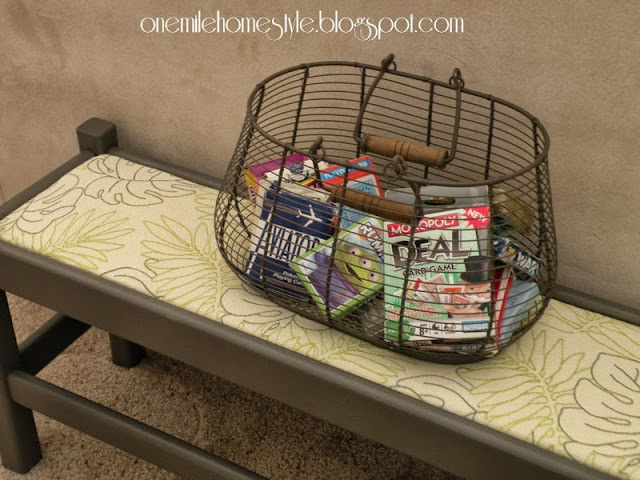 Dark Gray bench with leaf fabric and basket of cards