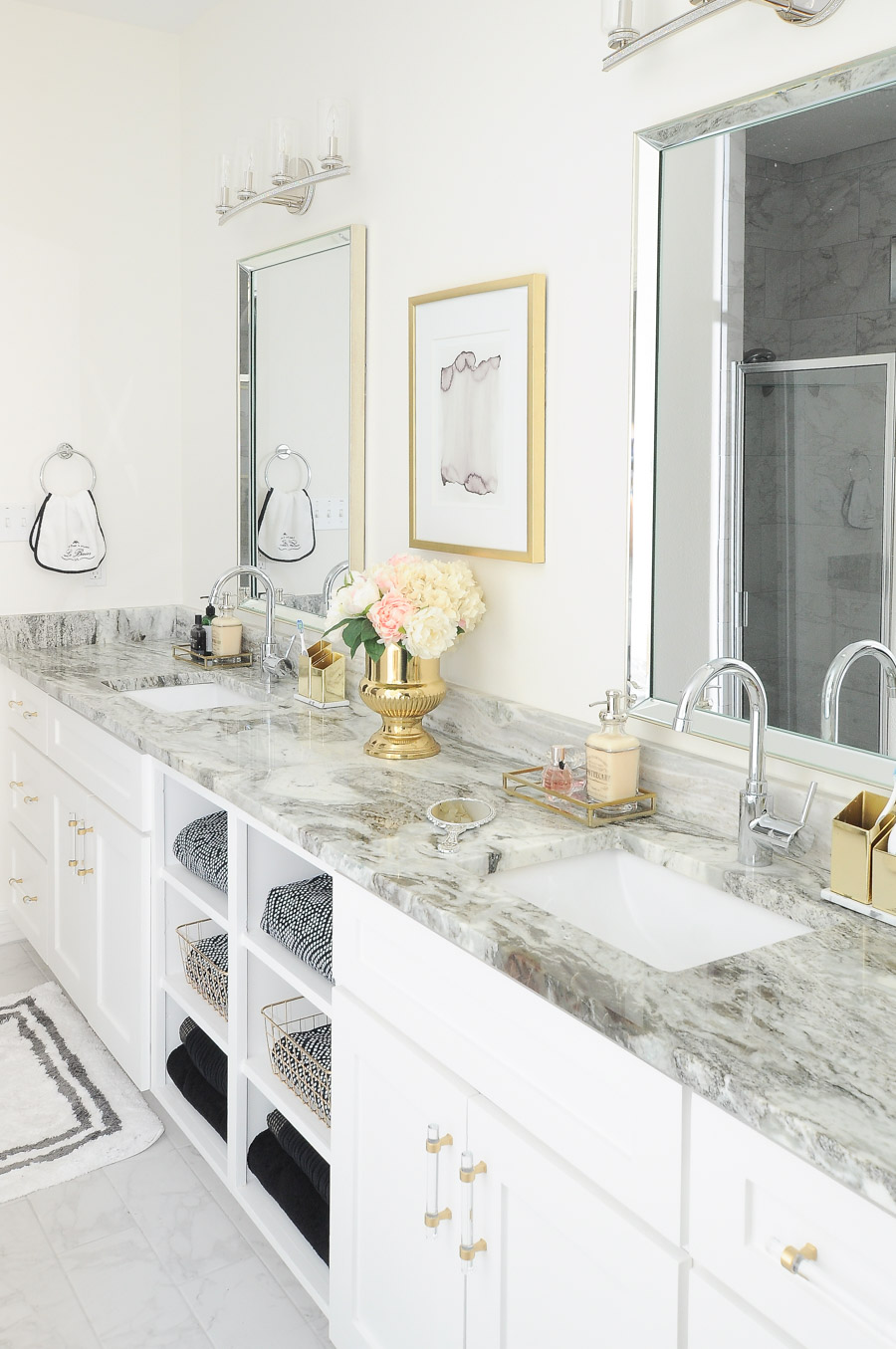 A white master bathroom with gold lucite cabinet pulls, alabaster walls, fantasy brown granite and a luxe vibe. | #bathroom #bathroomdesign #masterbathroom