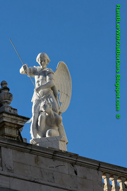 St Michael slaying Satan, Almudena Cathedral, Madrid, Spain