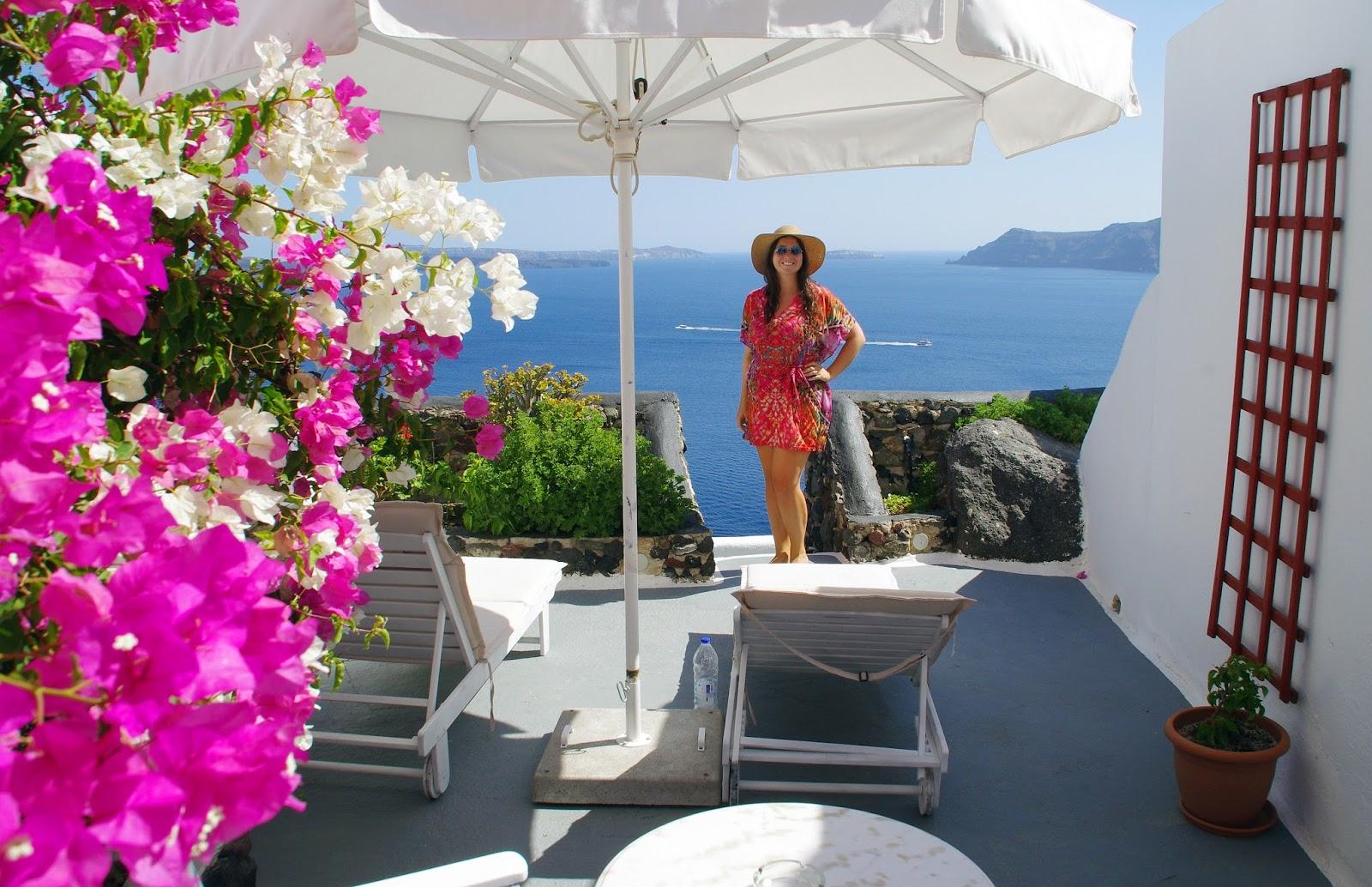 Girl on balcony Nostos Apartments Oia Santorini