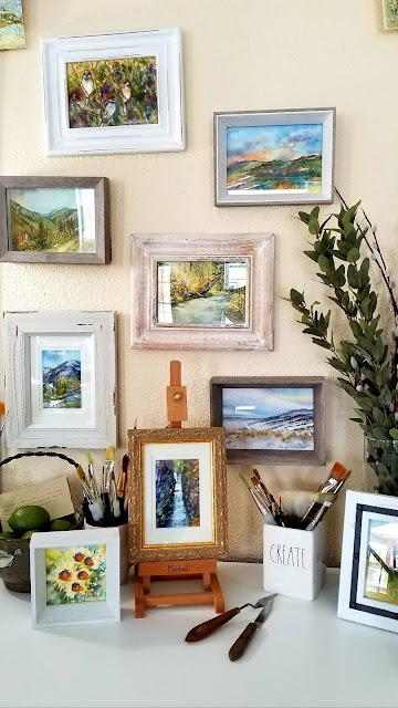 Framed original watercolors displayed in my art room.