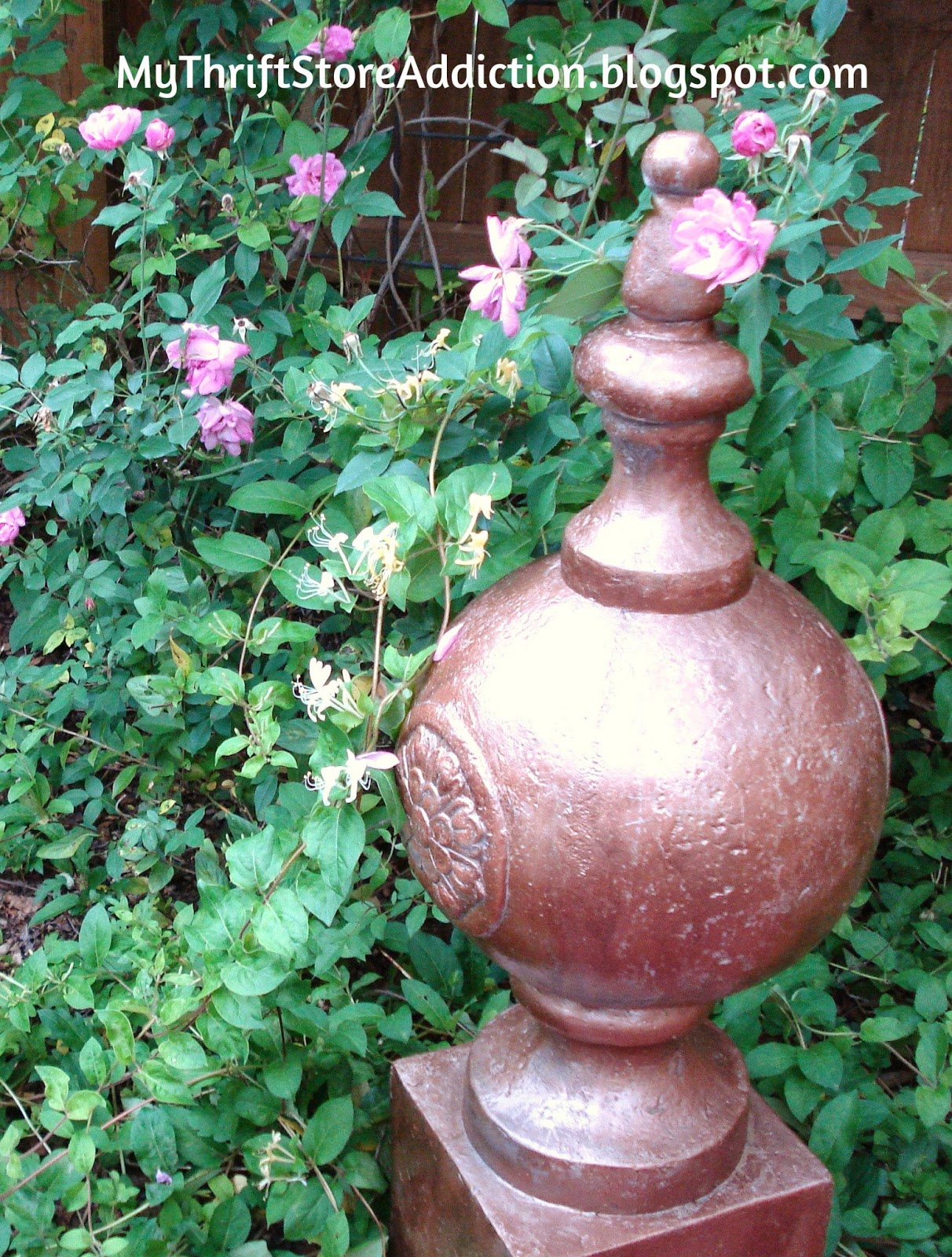 Welcome to Secret Garden: My Creative Space! mythriftstoreaddiction.blogspot.com A yard sale finial painted copper pops against the greenery and pink roses