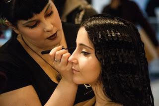 makeup artist using liquid eyeliner on woman.jpeg