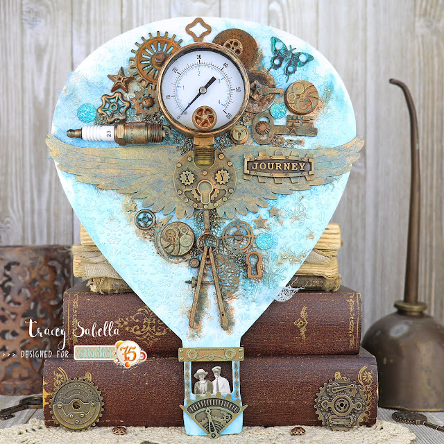 """Journey"" Industrial Steampunk Hot Air Balloon by Tracey Sabella for Studio75: #traceysabella #studio75 #woodouts #mitformcastings #scrapiniec #finnabair #primamarketing #snipart #lindysgang #timholtz #helmar #industrial #steampunk #rust #mixedmedia #masculine #hotairballoon #vintage #wings #fleamarketfinds"