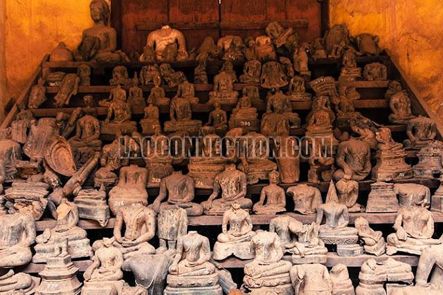 Damaged and headless Buddha statues in Laos