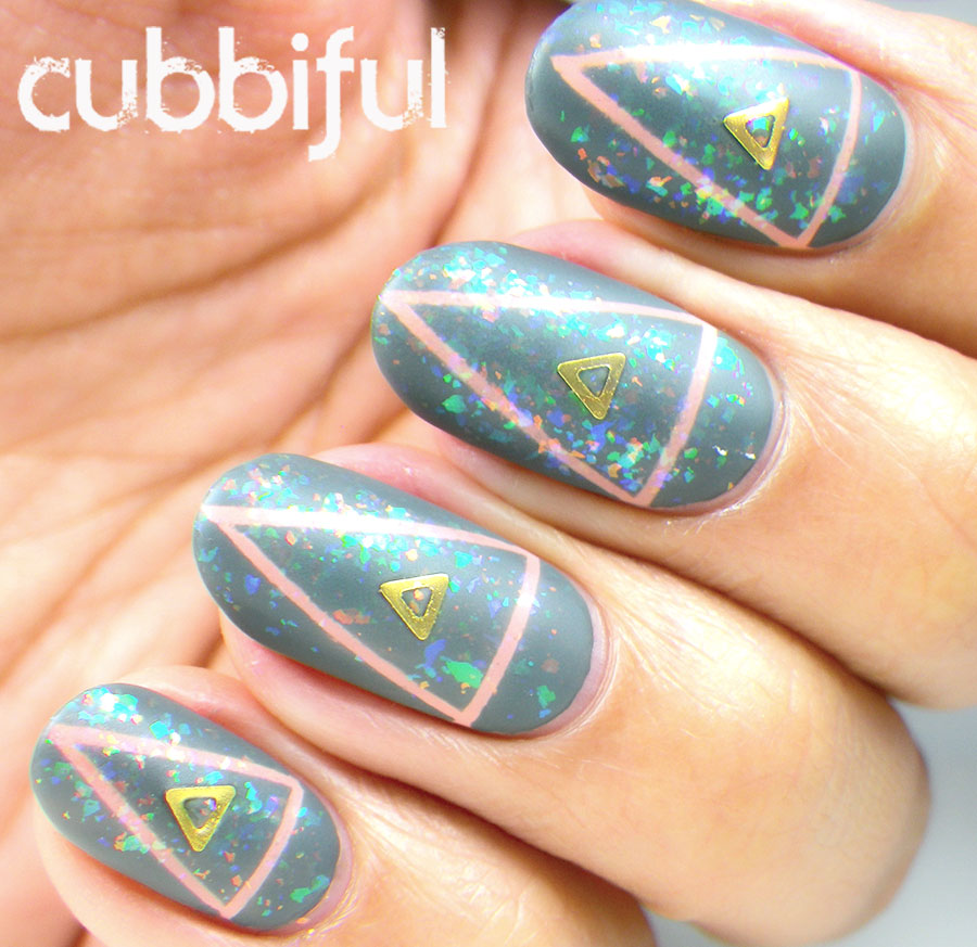 matte flakies in a geometric tape manicure