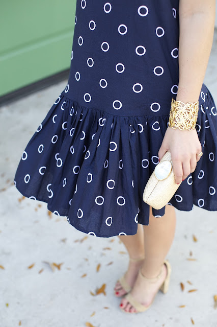 Navy dress and straw clutch