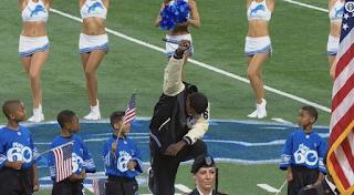 Singer takes knee after singing national anthem in Detroit