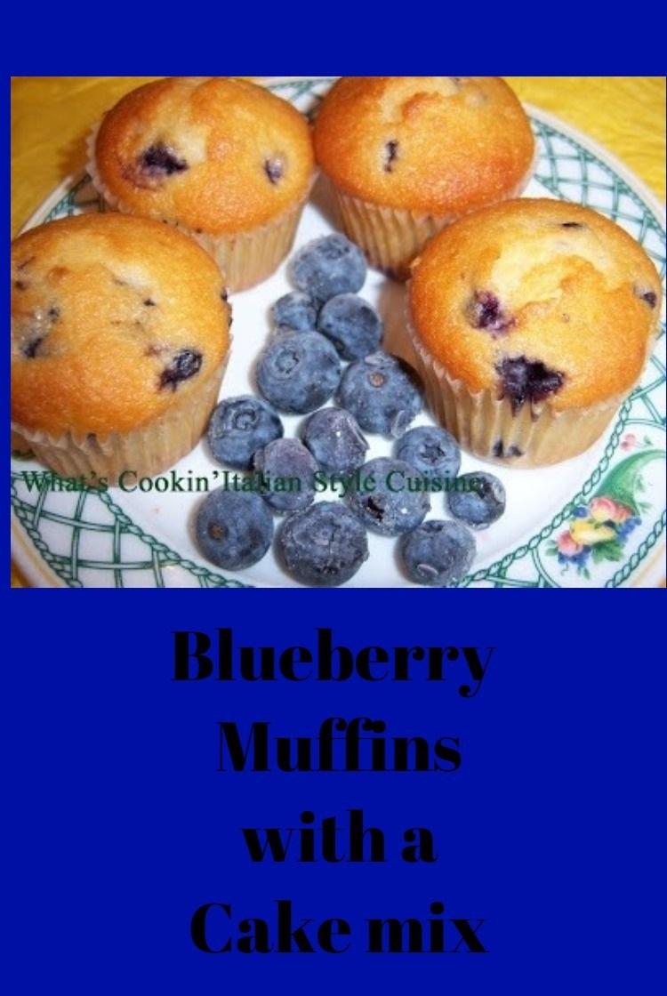 these are blueberry muffins made with a cake mix doctored to taste like homemade from scratch. Four muffins are on a lenox china plate with a few fresh blueberries