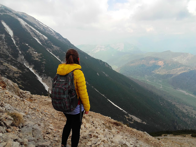 Girl during her hiking experience on Monte Baldo, in Italy.