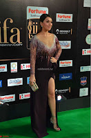 Hansika Motwani in Glittering Deep Neck Transparent Leg Split Purple Gown at IIFA Utsavam Awards 15.JPG