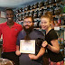 Orange Cat Coffee Co. employees accept award for Best-Locally Owned Coffee Shop