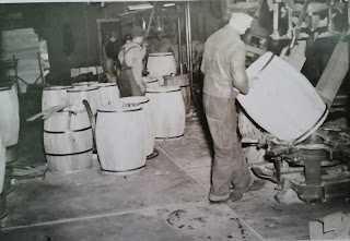 Coopers working with barrels