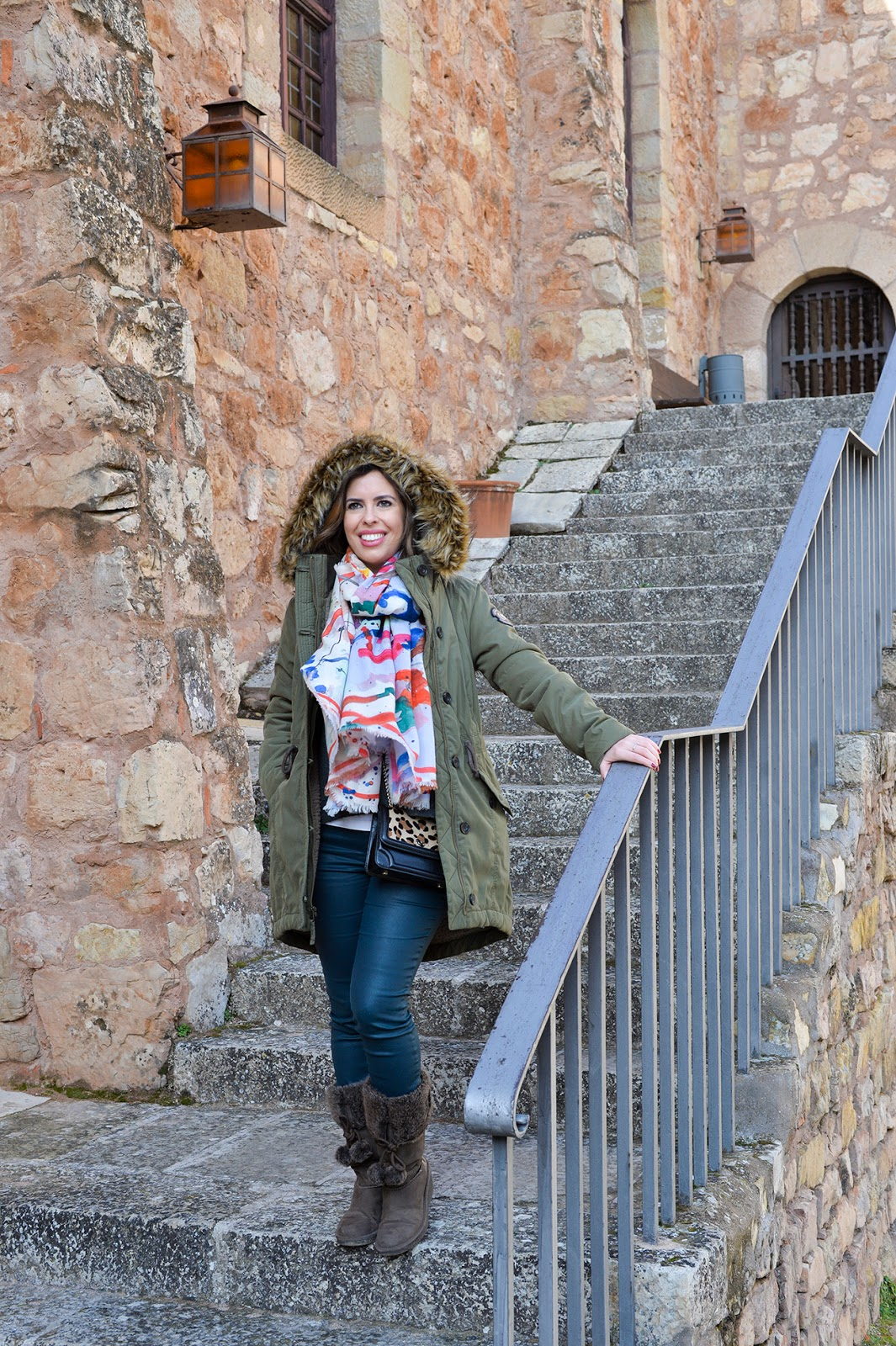 winter travel outfit parka pom-pom snow boots castillo parador sigüenza castle spain españa