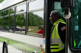 MATA operator at the door of a bus