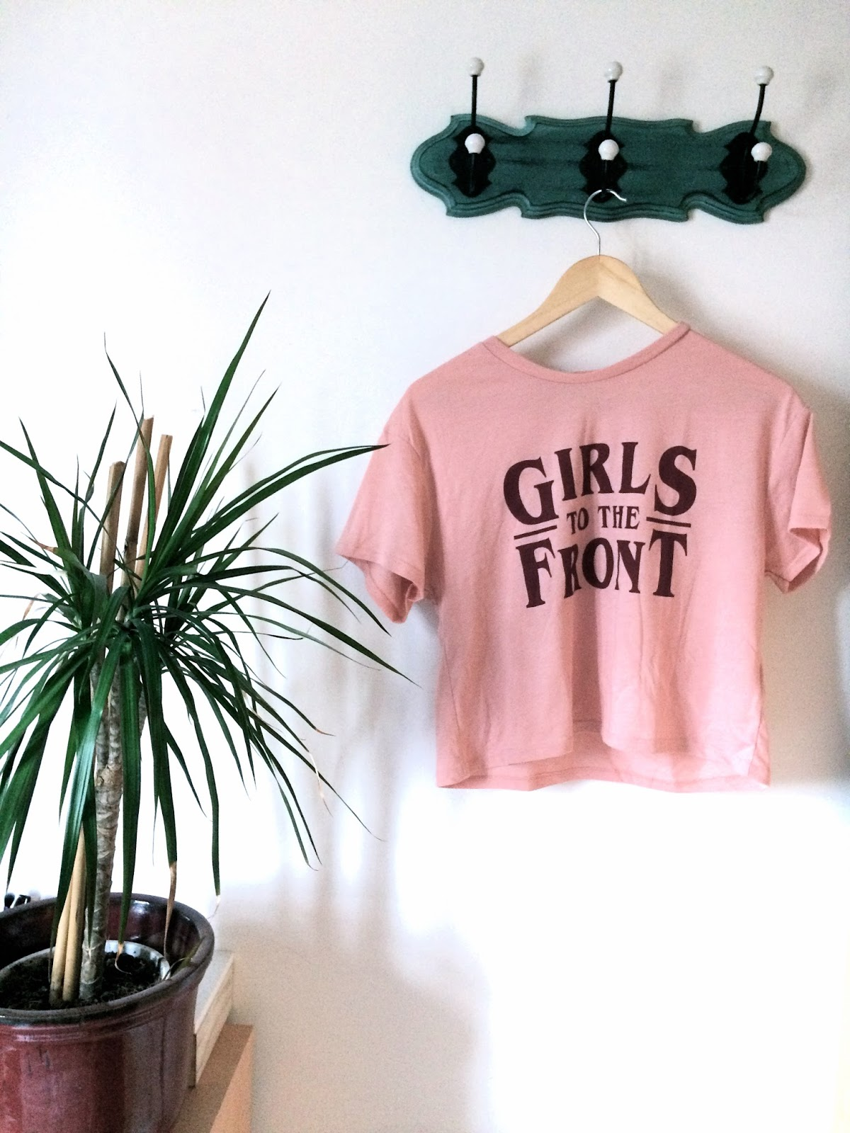 A pink t-shirt with slogan 'Girls to the Front'