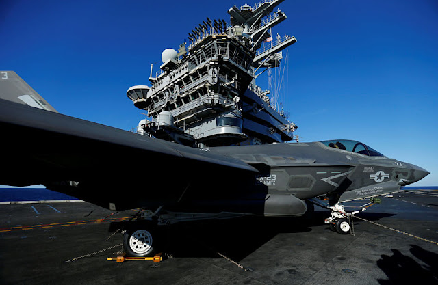 FILE PHOTO: A Lockheed Martin Corp's F-35C Joint Strike Fighter is shown on the deck of the USS Nimitz aircraft carrier after making the plane's first ever carrier landing using its tailhook system, off the coast of California, November 3, 2014. REUTERS/Mike Blake/File Photo