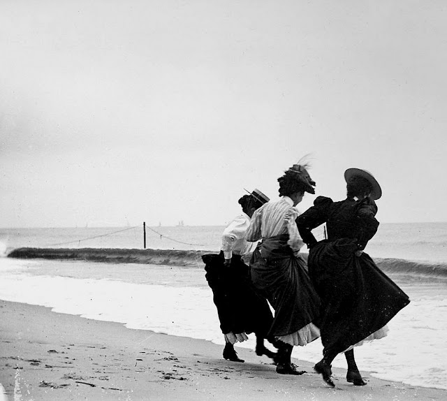 Vintage Photo. The girlfriends hiking their skirts above their ankles at the shoreline of the beach in Arverne, Queens, New York, 1897. Deadly Dullness, A Word to Women by Mrs. C. E. Humphry, 1898. marchmatron.com.jpg