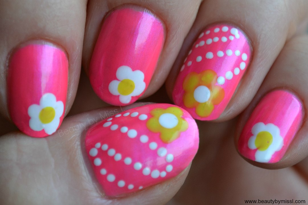 neon pink manicure with white and yellow flowers