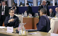 France's President Nicolas Sarkozy gestures towards President Obama during the G20 Summit November 3, 2011.