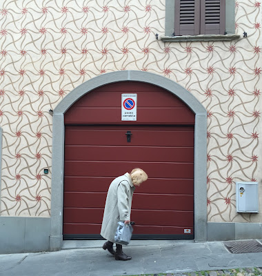 A woman walks up Via Sant'Alessandro