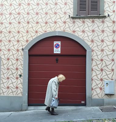 A woman walks up Via Sant'Alessandro