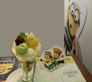 Shitty photoshop job of some fancy ice cream. Cute cut out minion are on the table reaching for it.